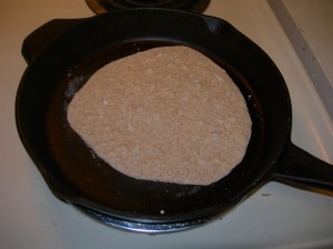 cooking one of the wheat tortillas